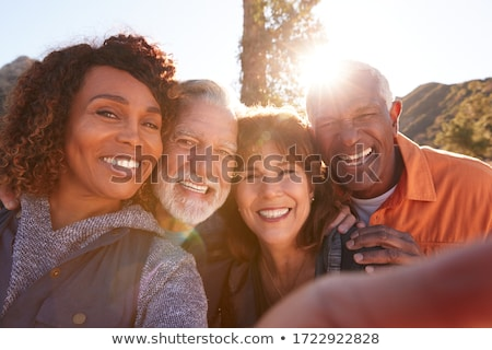 Happy senior couple posing for a selfie Stock photo © Witthaya