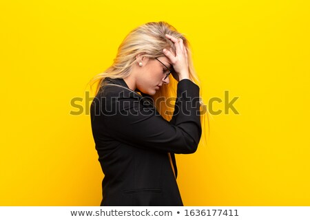Afraid scared business woman Stock photo © phakimata