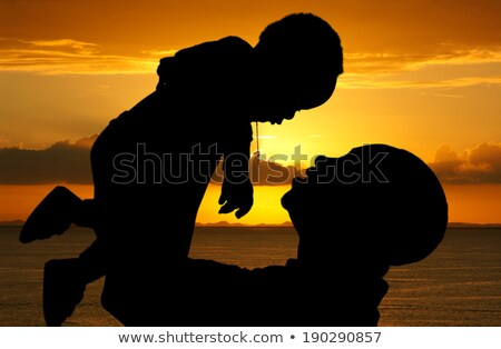 African child silhouette at sunset Stock photo © adrenalina