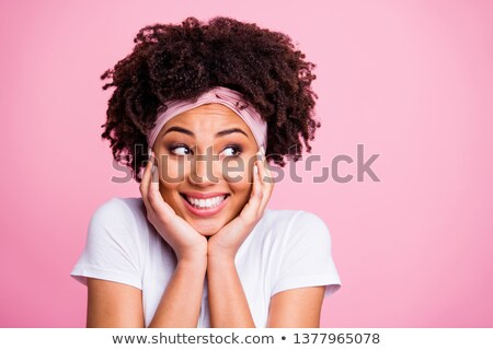 curious african american girl looking to the side stock photo © ozgur