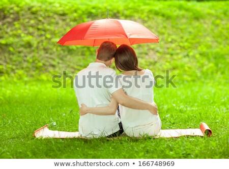 couple sit on the meadow under umbrella stock photo © Paha_L