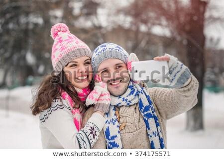 молодые · улыбаясь · пару · автопортрет · смартфон - Сток-фото © deandrobot