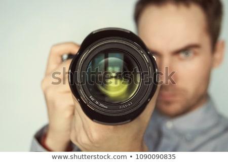 Casual man aiming at camera Stock photo © deandrobot