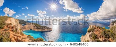 Hajóroncs trópusi sziget naplemente kalóz vitorla csónak Stock fotó © ankarb