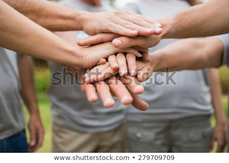 Boldog önkéntes család kezek együtt napos idő Stock fotó © wavebreak_media