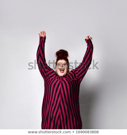 Woman in striped gold and black dress isolated on white Stock photo © Elnur