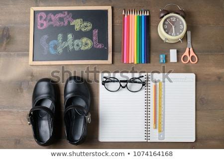 kid shoes on schooltable stock photo © fuzzbones0