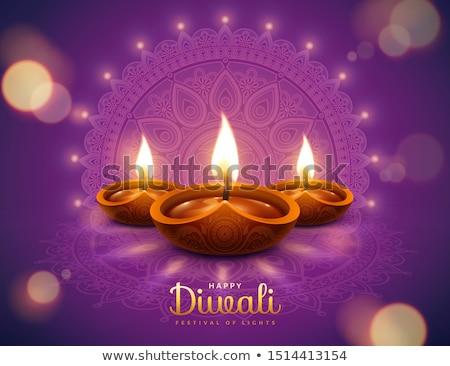 festival greeting of diwali with diya and bokeh effect Stock photo © SArts