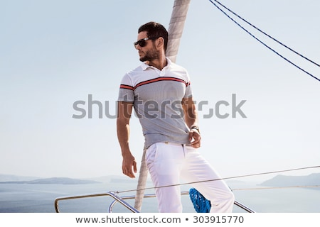 Smiling man on boat Stock photo © bezikus