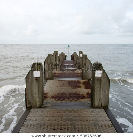 weathered wooden jetty in aberystwyth wales uk stock photo © latent