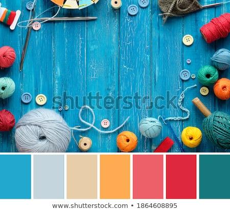 close up of turquoise knitting yarn ball on wood Stock photo © dolgachov