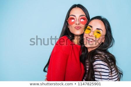 twee · meisjes · glimlachend · poseren · samen · portret - stockfoto © NeonShot