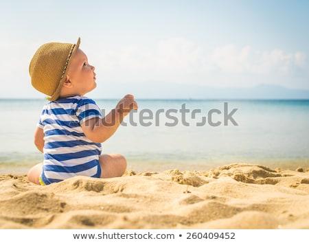 kicsi · fiú · tenger · szőke · egyéves · ül - stock fotó © tekso