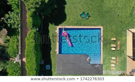 человека надувной матрац Бассейн лет Сток-фото © stevanovicigor