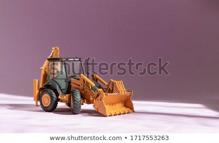 Toy bulldozer isolated on white background Stock photo © Nobilior