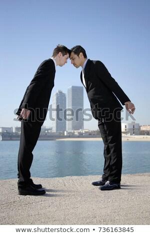 Homens de negócios cabeça empresário blue sky europa em pé Foto stock © IS2