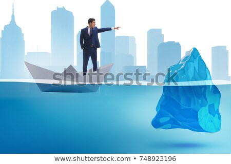 Businessman pointing and hits Stock photo © alphaspirit