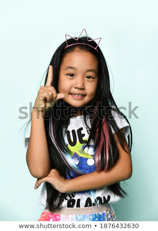 girl with a strand on the finger Stock photo © Traimak
