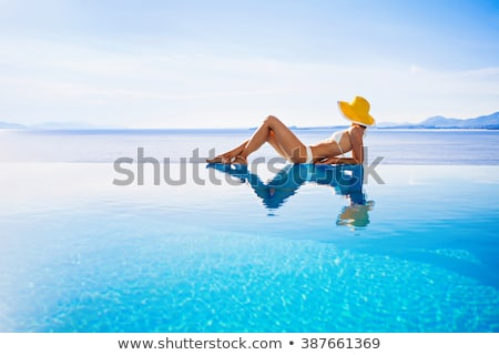 Portrait of woman in hotel pool Stock photo © IS2