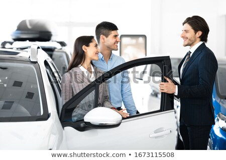 dealer opening car door for young couple stock photo © andreypopov