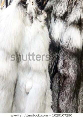 Black marble and dark arctic fox furs Stock photo © boggy