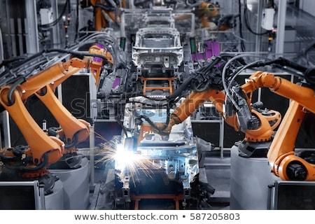 Welder working in car factory Stock photo © Kzenon