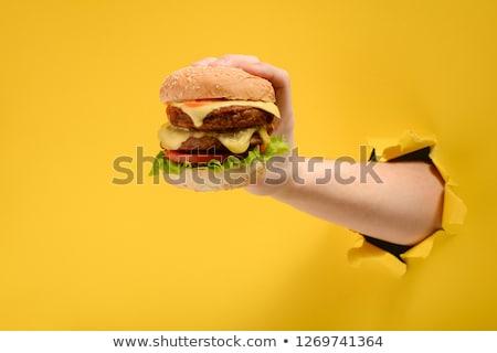 Burger on hand. fast food Stock photo © studiostoks
