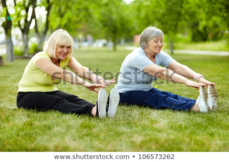 Senior lady enhancing body flexibility by stretching Stock photo © boggy