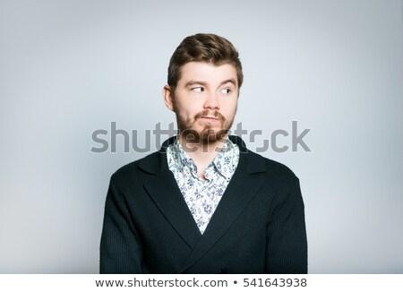 Retrato curioso empresario mirando lado pie Foto stock © feedough