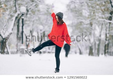 Сток-фото: девушки · весело · вверх · снега · ногу