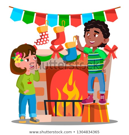 Twee kinderen opknoping christmas sokken ingericht Stockfoto © pikepicture