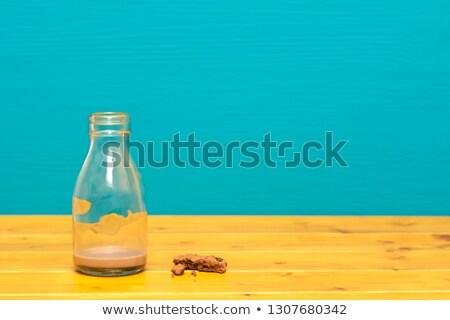 Melk fles chocolade cookie kruimels pint Stockfoto © sarahdoow