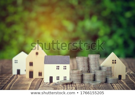 house model behind stacked coins stock photo © andreypopov
