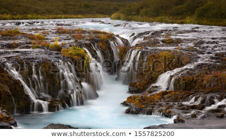 Vízesés türkiz szín Izland víz gyönyörű Stock fotó © Kotenko