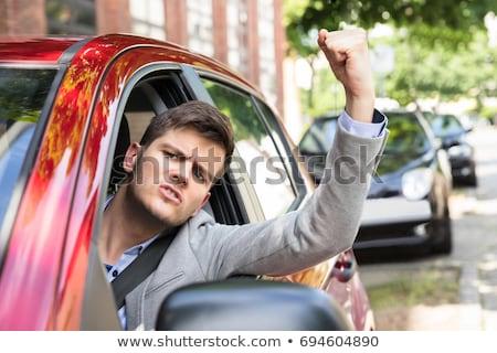 öfkeli adam bakıyor dışında araba Stok fotoğraf © deandrobot
