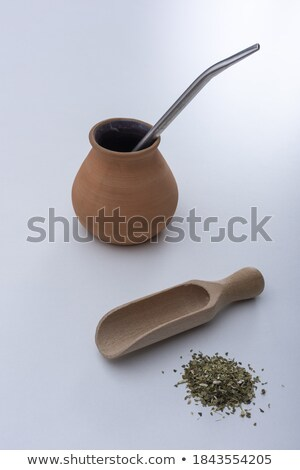 Pepper on wooden spoon and metal mortar with pestle Stock photo © Melnyk