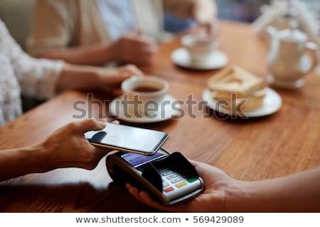 Smartphone by payment machine Stock photo © pressmaster