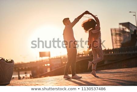 couple dancing at sunset stock photo © adrenalina