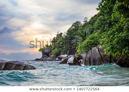 Dramatik gökyüzü gün batımı ada Seyşeller plaj Stok fotoğraf © AndreyPopov