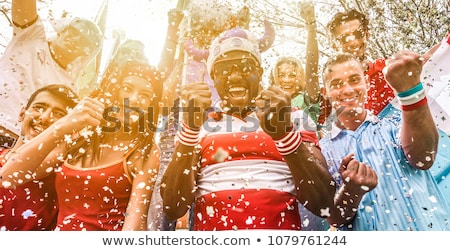 Group of young friendly sports fans gathered together outdoors Stock photo © pressmaster