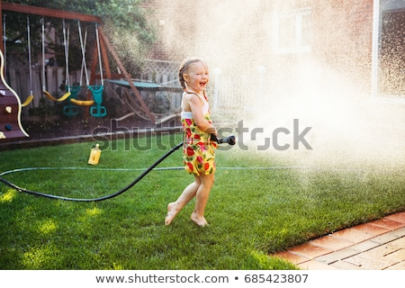 Summer joy for cute kid at the backlit sunset Stock photo © Lopolo