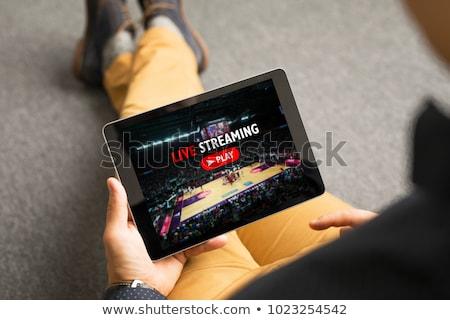 Homem assistindo viver esportes digital comprimido Foto stock © AndreyPopov