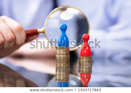 Man Looking With Magnifying Glass At Gender Pay Gap Stock photo © AndreyPopov