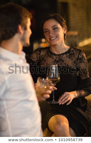 woman drinking wine with her man at restaurant Stock photo © dolgachov