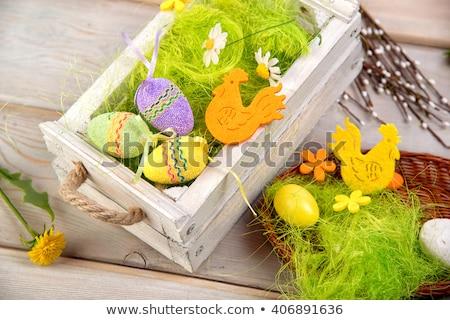 Czekolady Easter Eggs słomy gniazdo tabeli Wielkanoc Zdjęcia stock © dolgachov