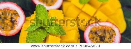 banner mango and passion fruit on an old wooden background long format foto stock © galitskaya