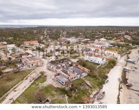 Aerial overhead houses on a tropical island, damaged by a cyclone Stock photo © timwege