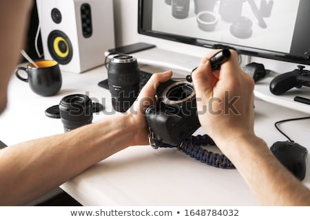 Man Cleaning DSLR Camera Sensor Stock photo © AndreyPopov