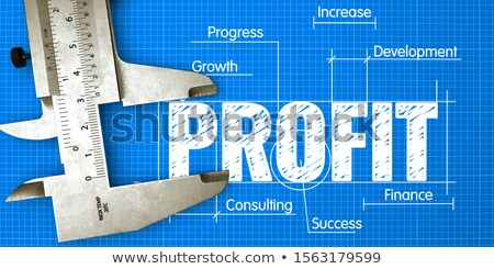 Profit Measuring Business Concept With Blueprint And Caliper Foto stock © Tashatuvango