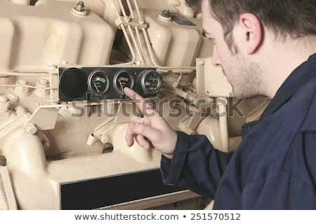 Generator  in a hospital with a repair men. Stock photo © Lopolo